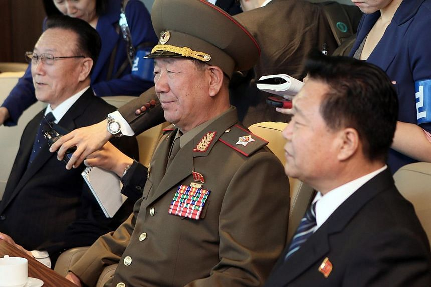 Mr Kim Yang Gon (left), head of the United Front Department of the ruling Workers' Party of North Korea who is in charge of relations with the South, Mr Hwang Pyong So (centre), director of the military's General Political Bureau, the top military po
