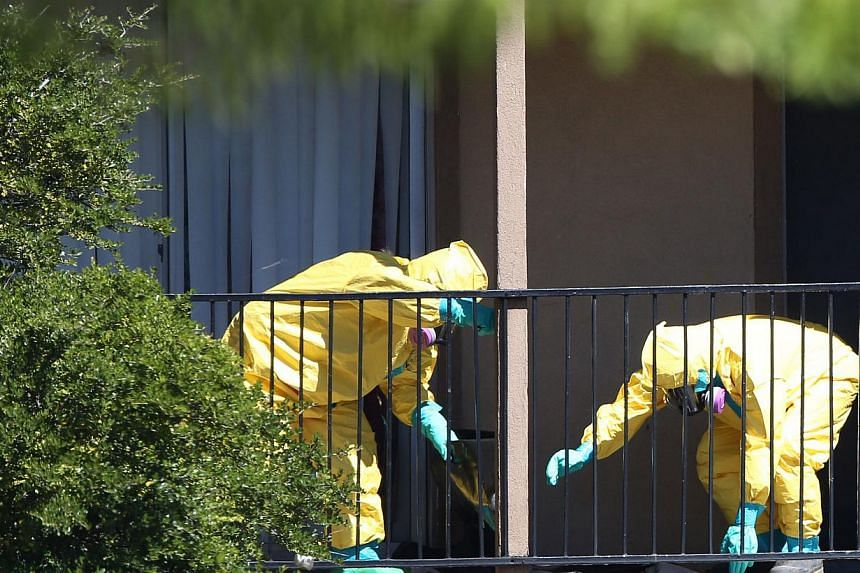 A hazmat team arrives to clean a unit at the Ivy Apartments, where the confirmed Ebola virus patient was staying, in Dallas, Texas on Oct 3, 2014. -- PHOTO: AFP