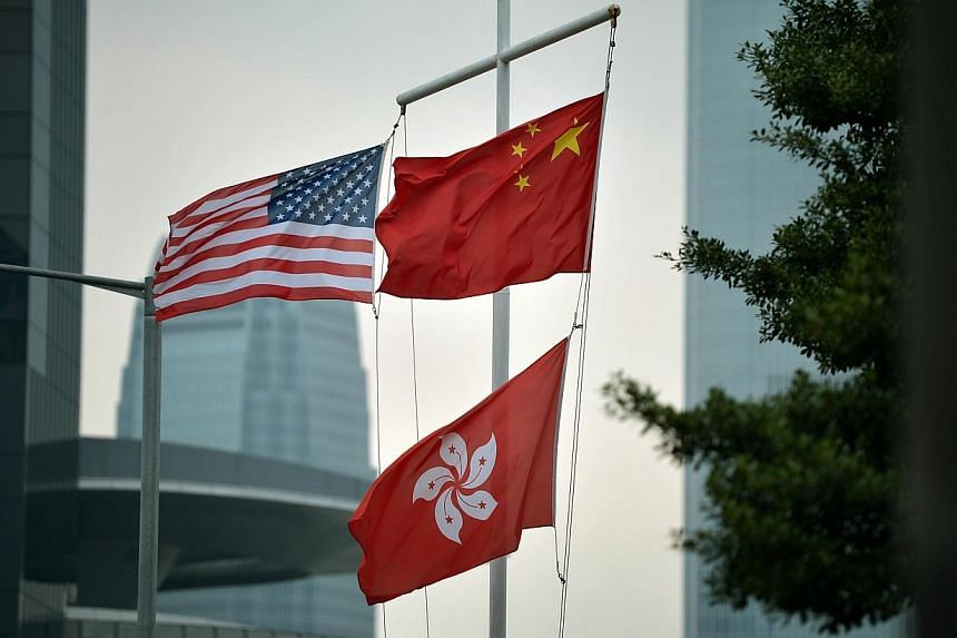 The United States, China and Hong Kong flags at a building near the main protest site in Harcourt Road in Hong Kong on Oct 4, 2014. -- ST PHOTO: KUA CHEE SIONG