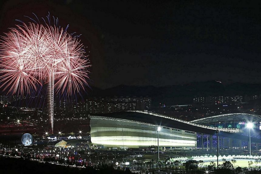 Fireworks explode near the Incheon Asiad Main Stadium during the closing ceremony of the 17th Asian Games on Oct 4, 2014. -- PHOTO: REUTERS
