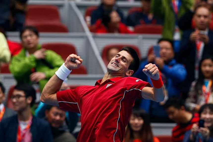 Novak Djokovic of Serbia celebrates after winning against Andy Murray of Britain during their men's singles semi-final match at the China Open tennis tournament in Beijing on Oct 4, 2014.World No. 1 Novak Djokovic maintained his perfect tournam