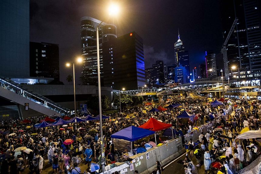 Protesters gather at Admiralty district in Hong Kong on Oct 3, 2014. - PHOTO: AFP