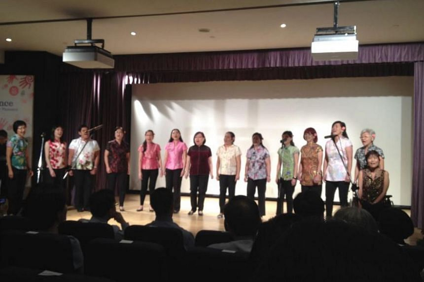 """Members of the KKH choir presenting their renditions of """"Memory"""" and """"Ye Lai Xiang"""" to over 400 healthcare pioneers at the hospital's pioneer generation tribute event on Saturday. -- ST PHOTO: JOANNA SEOW"""