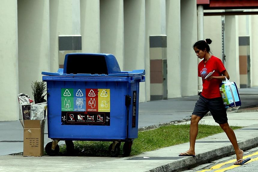 The NEA's move to put a bin at each block is part of a larger initiative to raise Singapore's overall recycling rate to 70 per cent by 2030.