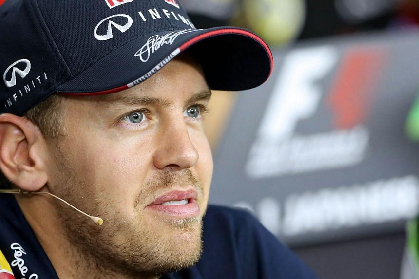 Four-time Formula One world champion Sebastian Vettel is leaving Red Bull at the end of the season and his seat will be taken by Toro Rosso's Daniil Kvyat, the team announced on Saturday. -- PHOTO: AFP