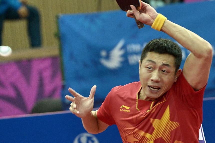 China's Xu Xin competes against South Korea's Lee Jungwoo in the table tennis men's team finals during the 2014 Asian Games at the Suwon Gymnasium in Incheon on Sept 30, 2014. -- PHOTO: AFP