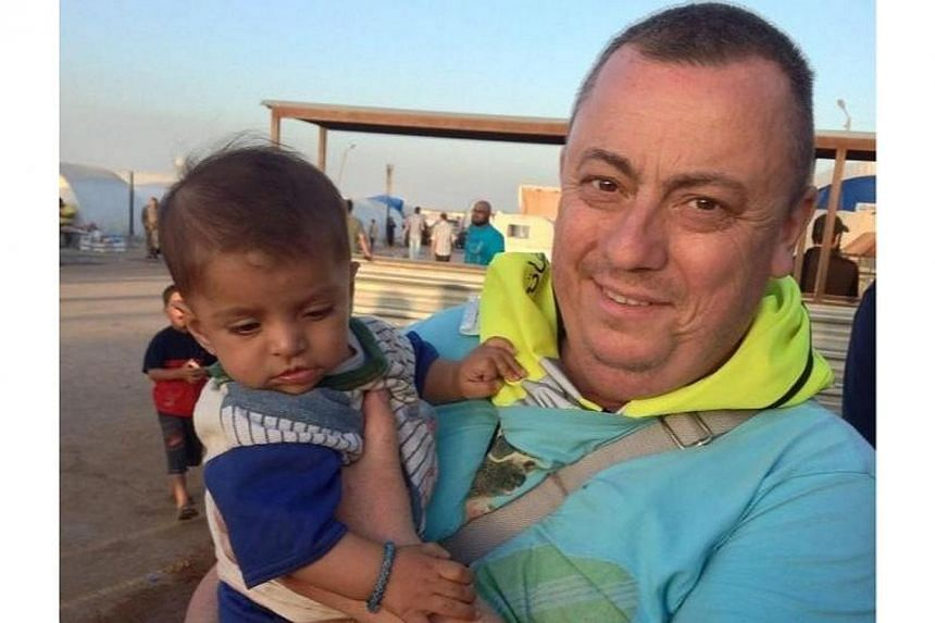 """An undated family handout photo of British aid worker Alan Henning taken at a refugee camp on the Turkish-Syria border. Described by hiswife Barbara as """"a peaceful, selfless man"""" who left his job as a taxi driver in Manchester, north-west Engla"""
