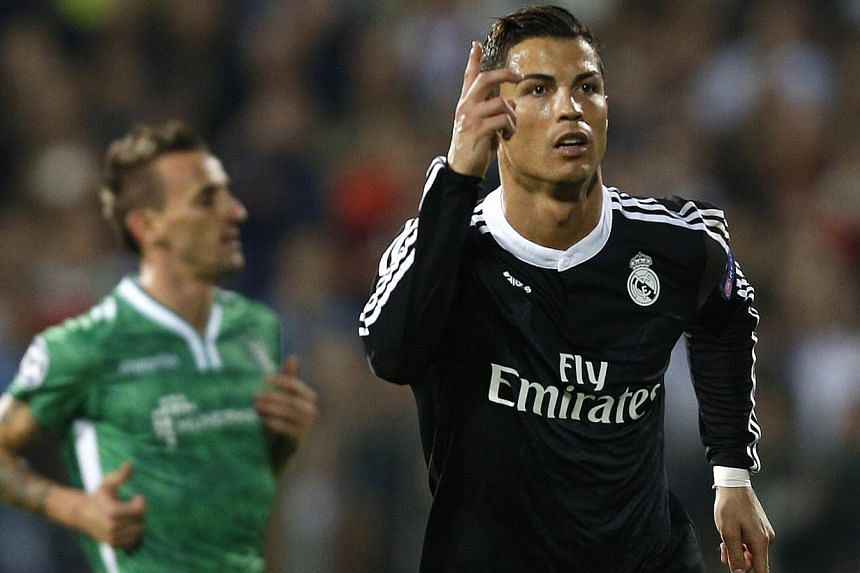 Cristiano Ronaldo of Real Madrid celebrates after scoring during their Champions League Group B soccer match against Ludogorets at Vassil Levski stadium in Sofia on Oct 1, 2014. -- PHOTO: REUTERS