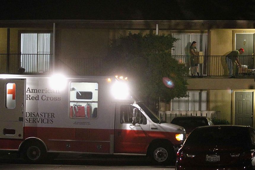 A Red Cross worker delivering bedding materials to an apartment unit at The Ivy Apartments, where a man diagnosed with the Ebola virus was staying in Dallas, Texas Oct 2, 2014.Texas health officials were monitoring 50 people for Ebola exposure