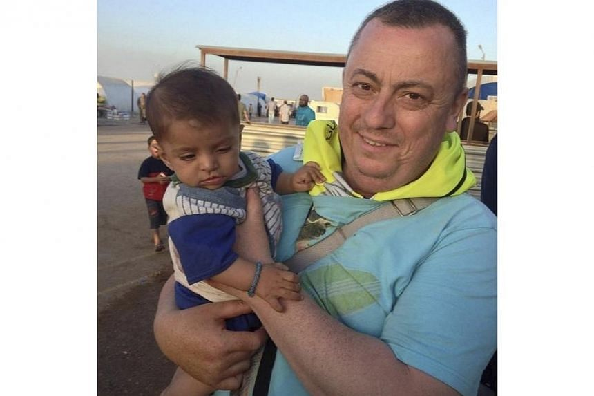 An undated family handout photo of British aid worker Alan Henning taken at a refugee camp on the Turkish-Syria border. -- PHOTO: REUTERS