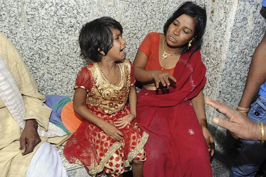 A girl and a woman cry outside an emergency hospital ward after their relatives were injured during a stampede in the eastern Indian city of Patna Oct 3, 2014. -- PHOTO: REUTERS