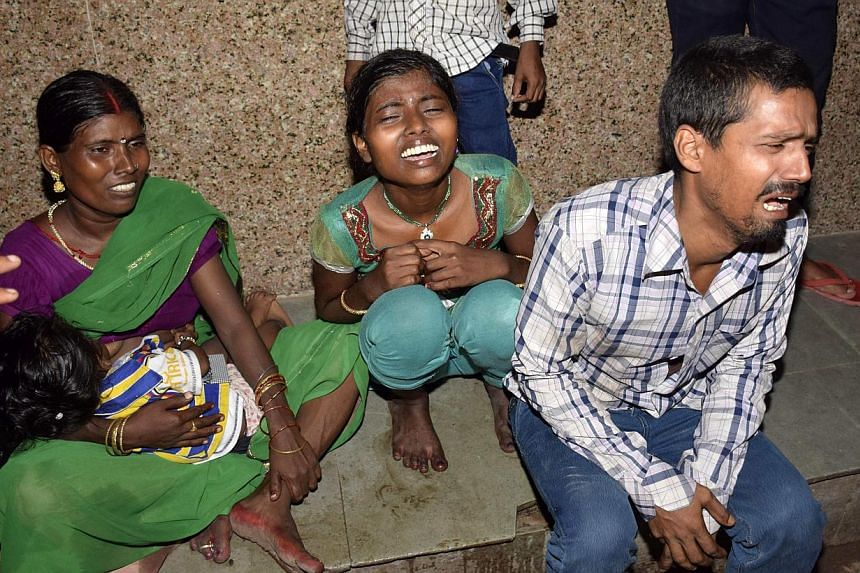 People cry outside an emergency hospital ward after their relatives were injured during a stampede in the eastern Indian city of Patna Oct 3, 2014. -- PHOTO: REUTERS