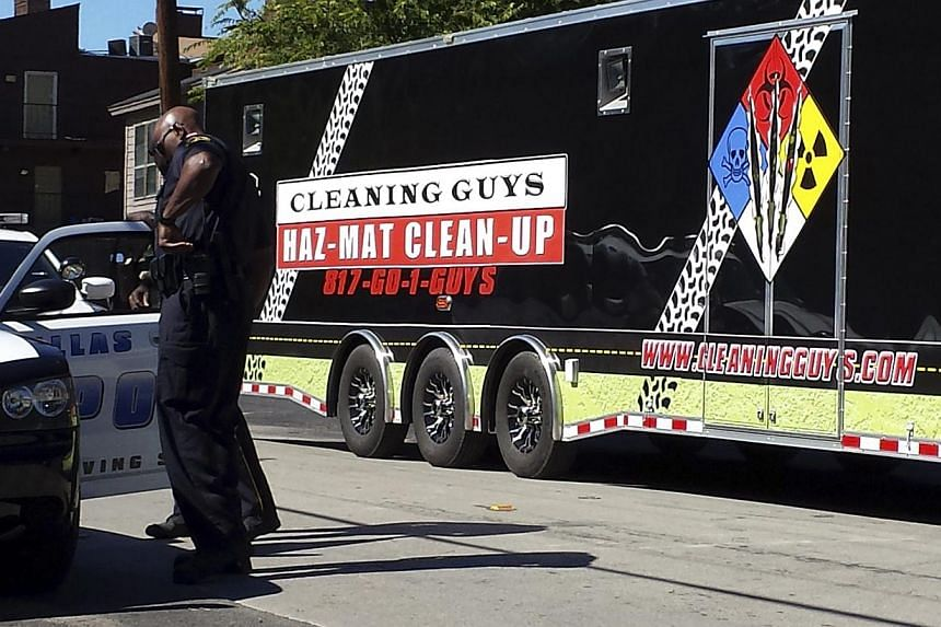 A hazardous materials cleanup trailer enters the apartment complex in Dallas, Texas Oct 3, 2014 where a Liberian man with Ebola stayed. The White House said Friday it has no plans to introduce travel bans to stop Ebola reaching the United States, aft