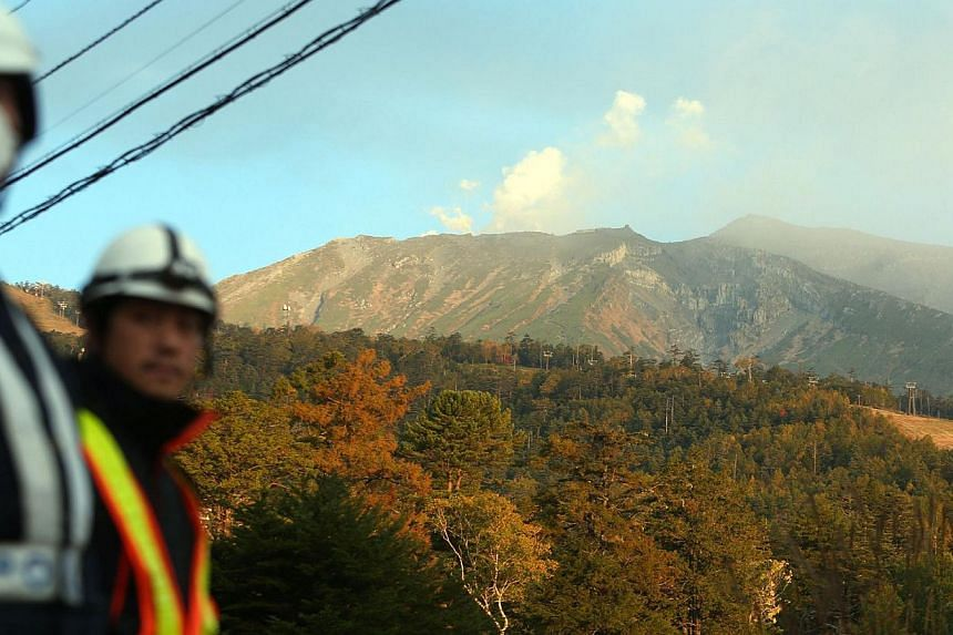 White smoke rises from Mount Ontake at Nagano prefecture on Oct 4, 2014, one week after the volcano erupted. -- PHOTO: AFP