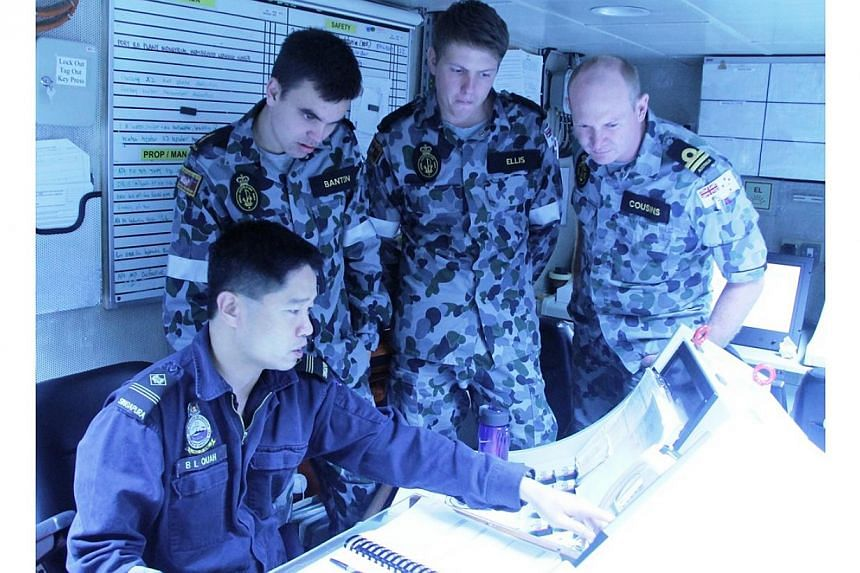 Personnel from the Singapore and Australian navies interacting during the exercise. -- PHOTO: MINDEF