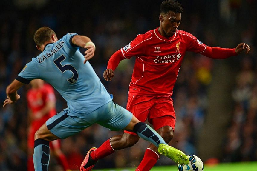 Liverpool's Daniel Sturridge (right) in action with Manchester City defender Pablo Zabaleta (left) during a Premier League match at the Etihad Stadium in Manchester, England, on Aug 25, 2014. AFP. Sturridge has committed his future to Liverpool by si