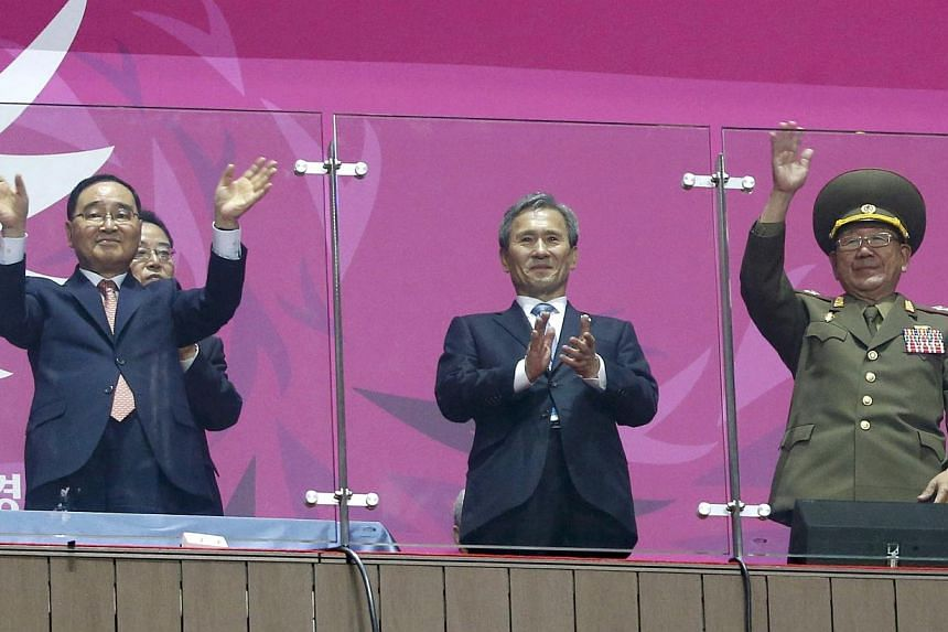 South Korea's Prime Minister Jung Hong-won (left), former South Korean minister for national defense Kim Kwan-jin (middle) and North Korea's Hwang Pyong So (right), a senior aide North Korea's leader Kim Jong Un, attend the closing ceremony of the 17