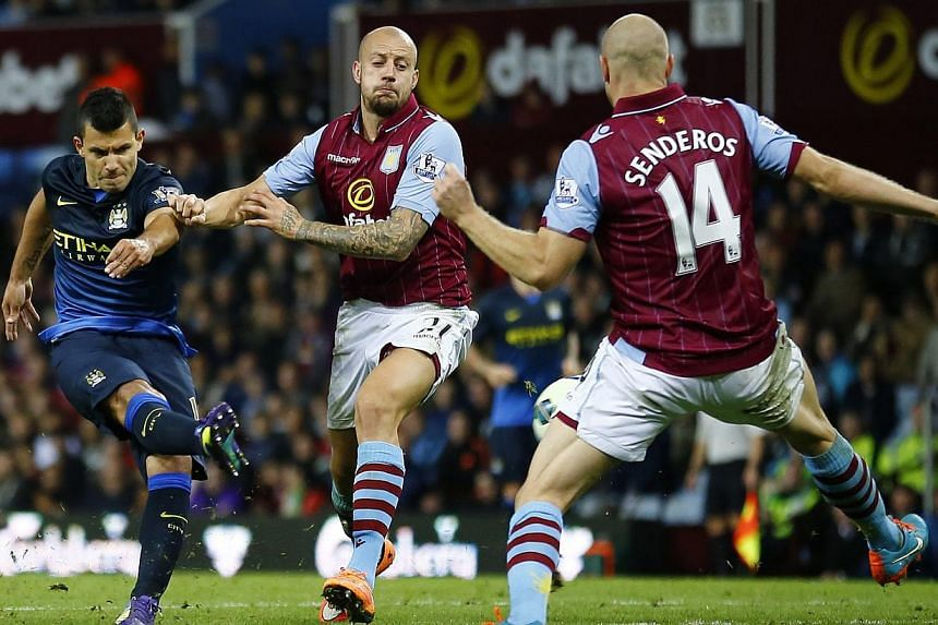 Manchester City's Sergio Aguero (left) shoots to score his side's second goal during their English Premier League match against Aston Villa at Villa Park in Birmingham on Oct 4, 2014. -- PHOTO: REUTERS