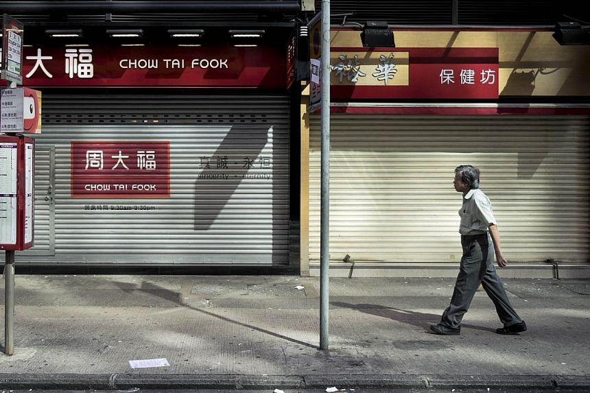 Shuttered stores near a protest site in Hong Kong on Sept 29, 2014. -- PHOTO: REUTERS