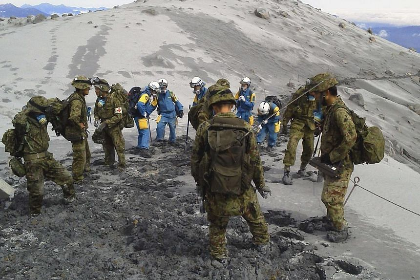 Japan Self-Defence Force (JSDF) soldiers conduct rescue operations on the Mount Ontake, which erupted on Sept 27, 2014. A search operation for people missing on a volcano in central Japan was called off on Sunday, Oct 5, more than a week after a