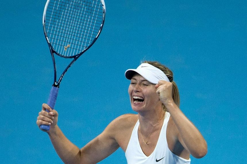 Maria Sharapova of Russia reacts after winning against Petra Kvitova of the Czech Republic during their women's singles final match at the China Open tennis tournament in the National Tennis Centre of Beijing on Oct 5, 2014, her first tennis title si