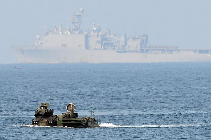 """Two assault vehicles (AAV) of the US marines 31st Marine Expeditionary Unit based in Okinawa Japan, manoeuvre in high seas before USS Germantown as part of the 12-day US and Philippine annual joint naval exercise dubbed """"Phiblex"""" along the coast in S"""