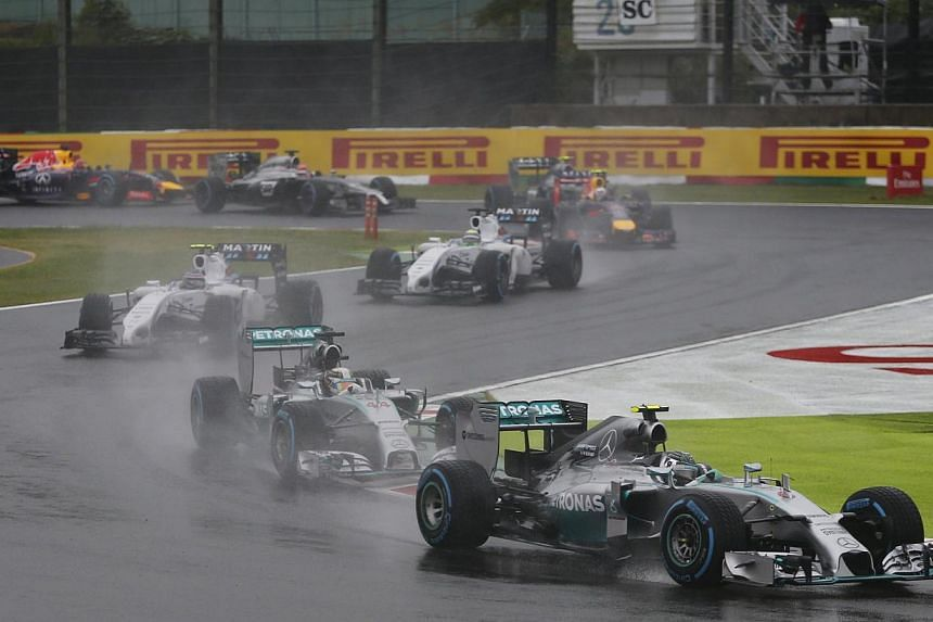 Mercedes Formula One driver Nico Rosberg of Germany leads as race is restarted following rain conditions during the Japanese F1 Grand Prix at the Suzuka Circuit on Oct 5, 2014. -- PHOTO: REUTERS