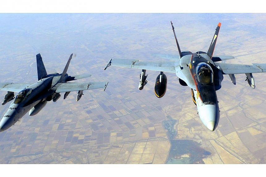 This Oct 4, 2014, US Navy handout image shows two US Navy F-18E Super Hornets supporting operations against IS, after being refueled by a KC-135 Statotanker over Iraq after conducting an airstrike.The US military unleashed a wave of air strikes