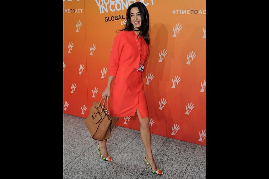 Wearing a coral dress and matching jacket at the Global Summit to End Sexual Violence in Conflict in London in June (above): Kudos to her for not shying away from bold colours during daytime. The coral dress and jacket look eye-catching as well as pr