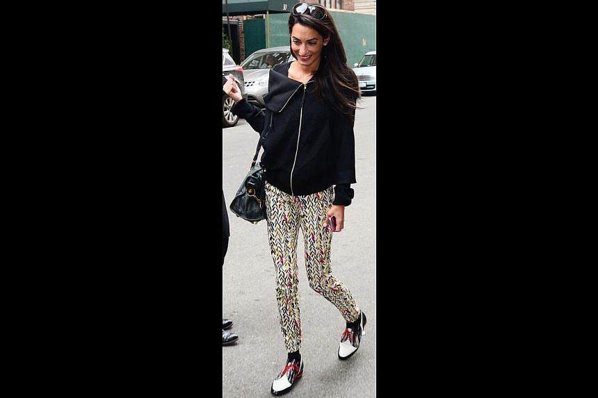 Wearing a jacket, pants and loafers in New York in March (above): While her style typically sticks to classic and elegant pieces, her casual pieces sometimes veer towards quirky, like this outfit. The jacket features an oversize collar, but the print