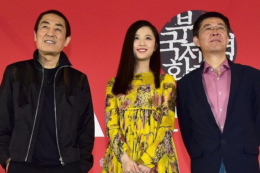 (From left) Chinese director Zhang Yimou, actress Zhang Huiwen and producer Zhang Zhao at a press conference on the gala presentation of the film Coming Home at the 19th Busan International Film Festival in Busan on Oct 4, 2014. -- PHOTO: AFP