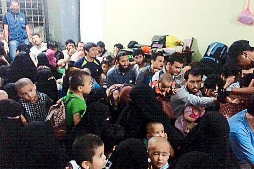A Malaysian human rights group called on the government Sunday not to forcibly deport 155 Chinese ethnic Uighurs reported to be in the country illegally, amid concerns for their fate in China. -- PHOTO:THE STAR/ASIA NEWS NETWORK