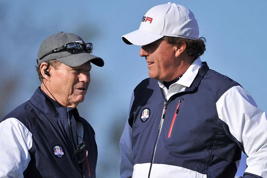 Phil Mickelson of Team US (right) speaks with US team captain Tom Watson during the first day of the Ryder Cup golf tournament at Gleneagles, Scotland, on Sept 26, 2014. Remarks by Mickelson against Tom Watson after a loss at Gleneagles came after th