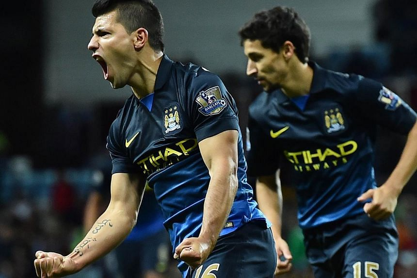Manchester City's Argentinian striker Sergio Aguero celebrates scoring their second goal during the English Premier League football match between Aston Villa and Manchester City at Villa Park in Birmingham, central England on Oct 4, 2014. Manchester