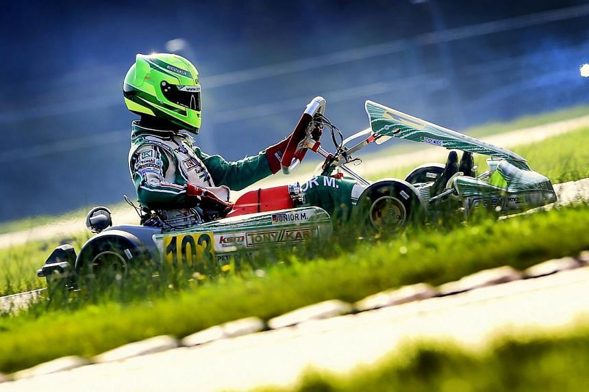Mick Schumacher, 15 year-old son of former F1 champion Michael Schumacher competes during the German Kart Championship International ADAC, in Genk, on Oct 4, 2014. -- PHOTO: AFP