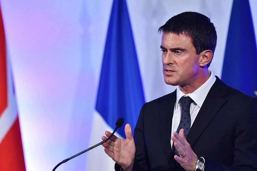 "French Prime Minister Manuel Valls delivers a speech at the Guildhall in London, on Oct 6, 2014. French Prime Minister Manuel Valls rebuked the head of a major British retailer on Monday for saying his country was ""in decline"", dismissing the co"