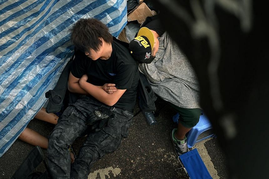 People sleeping on the street in Admiralty district in Hong Kong on Oct 6, 2014. -- ST PHOTO: KUA CHEE SIONG