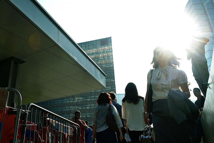 Office workers trying to get to work amid the diversions due to blockades by the protesters at the Central Government offices in Admiralty district in Hong Kong on Oct 6, 2014. -- ST PHOTO: KUA CHEE SIONG