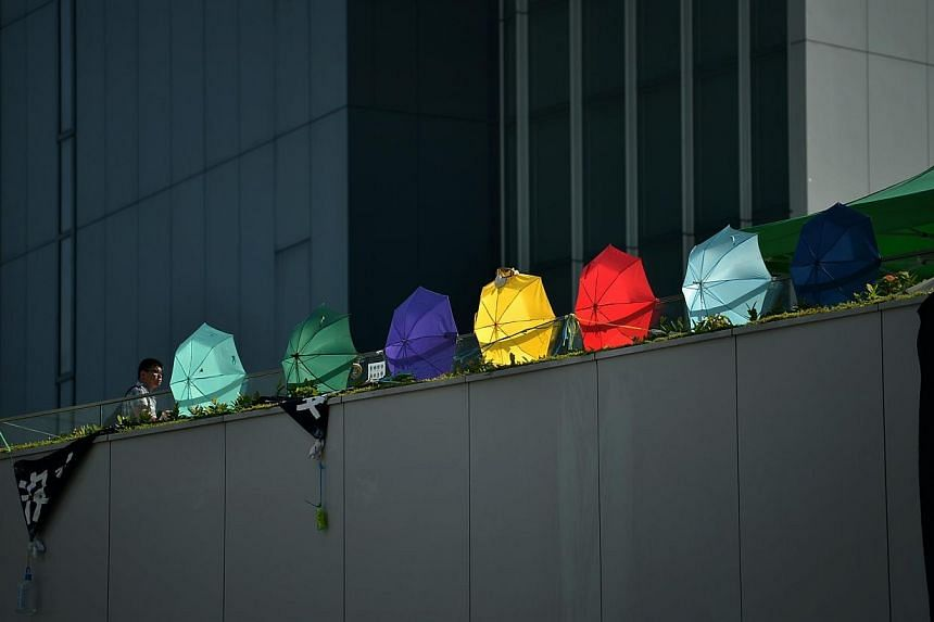 A row of umbrellas are seen in Hong Kong on Oct 6, 2014. -- ST PHOTO: KUA CHEE SIONG