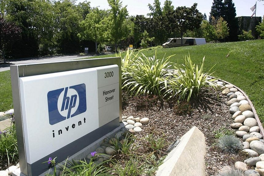 Hewlett-Packard said on Monday it would split into two separate, listed companies by separating its computer and printer businesses from its corporate hardware and services operations. -- PHOTO: AFP