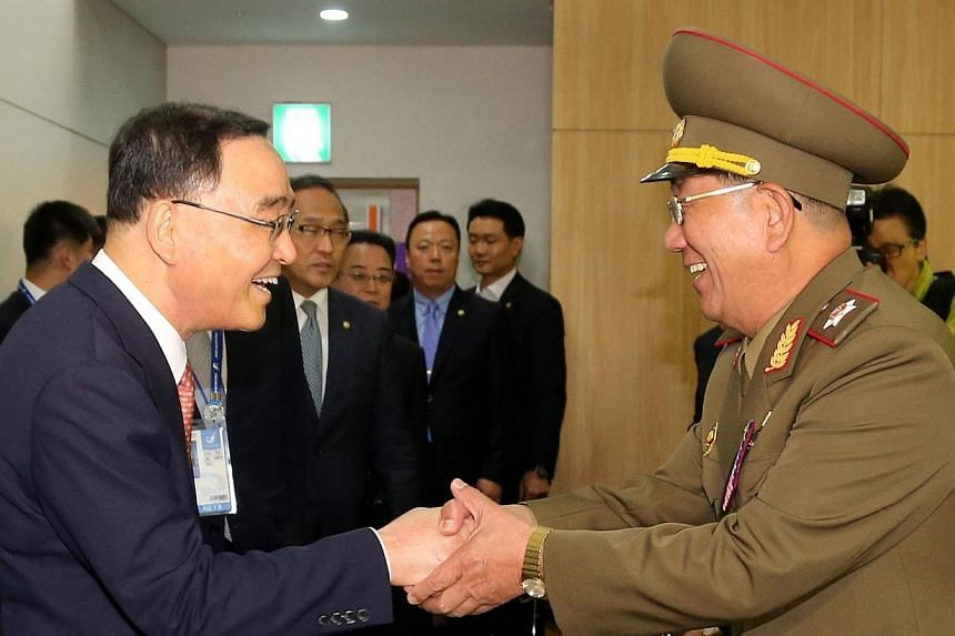 South Korean Prime Minister Chung Hong Won (left) shakes hands with Hwang Pyong So (right), director of the military's General Political Bureau, the top military post in North Korea, during their meeting in Incheon on Oct 4, 2014.South Korea on