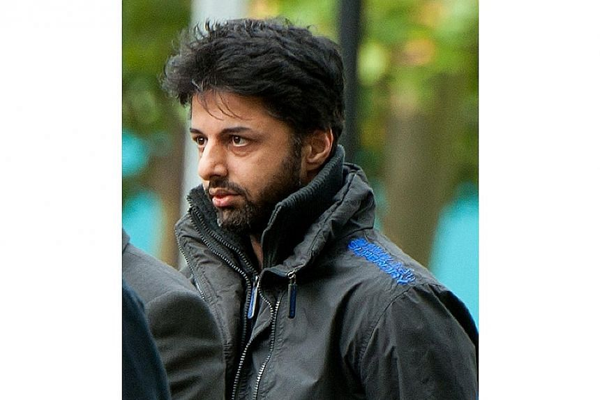 This file picture dated on Aug 10, 2011 shows Shrien Dewani arriving at Belmarsh Magistrates' Court sitting at Woolwich Crown Court in south London. Millionaire British businessman Shrien Dewani pleaded not guilty to charges of murdering his bri