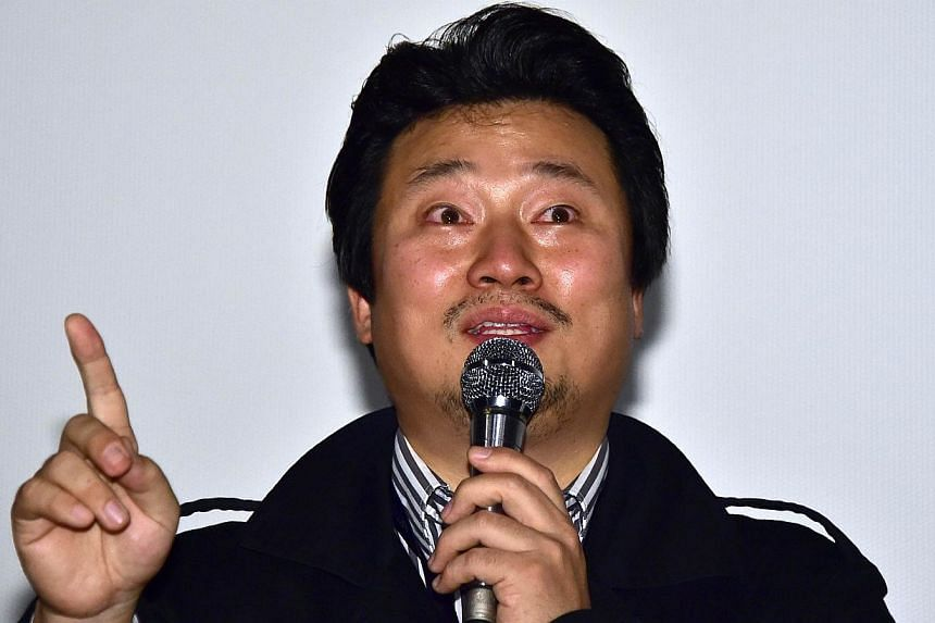 South Korean director Lee Sang Ho speaks at a guest visit event after a screening of his film Diving Bell, The Truth Shall Not Sink with Sewol, during the 19th Busan International Film Festival (BIFF) on Oct 6, 2014. The controversial film premi