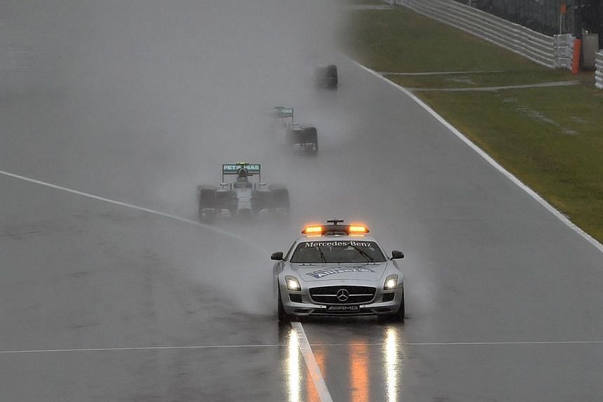 A safety car drives in front as the race was stopped due to heavy rain at the Formula One Japanese Grand Prix in Suzuka on Oct 5, 2014.Formula One must change its Safety Car protocol and make their deployment automatic with every crash, 2007 wo