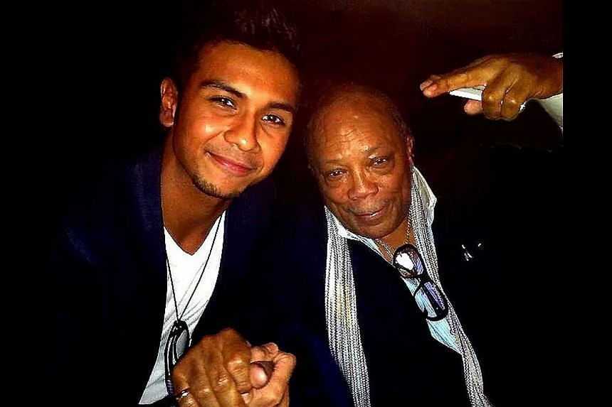 Taufik Batisah with American music producer Quincy Jones in 2011 (above), with older brother Mustaffa in 1986 and with mother Normainah Bachok in 1994. -- PHOTO: COURTESY OF TAUFIK BATISAH