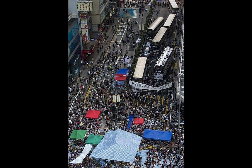 Thousands of protesters blocking the main road in Mong Kok last week. China views the protests as a local incident and Beijing has said it has confidence in the Hong Kong government to handle the situation.
