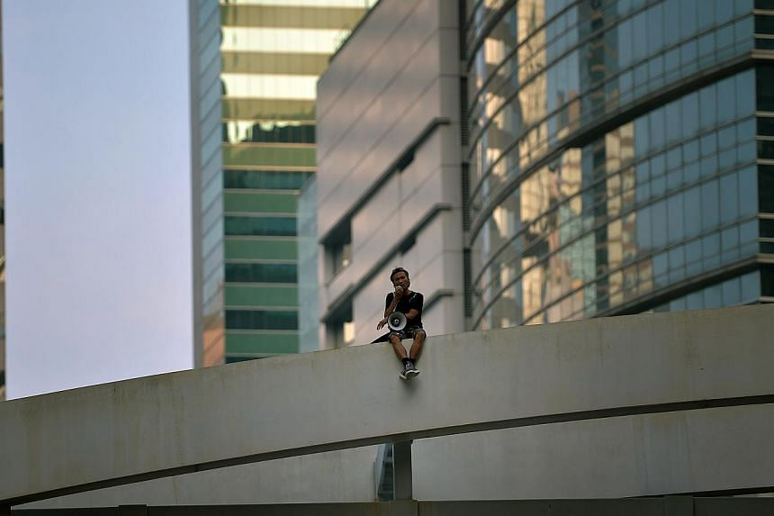 A man threatening to commit suicide on the bridge along Harcourt Road in the main protest area in Hong Kong on Oct 5, 2014. -- ST PHOTO: KUA CHEE SIONG