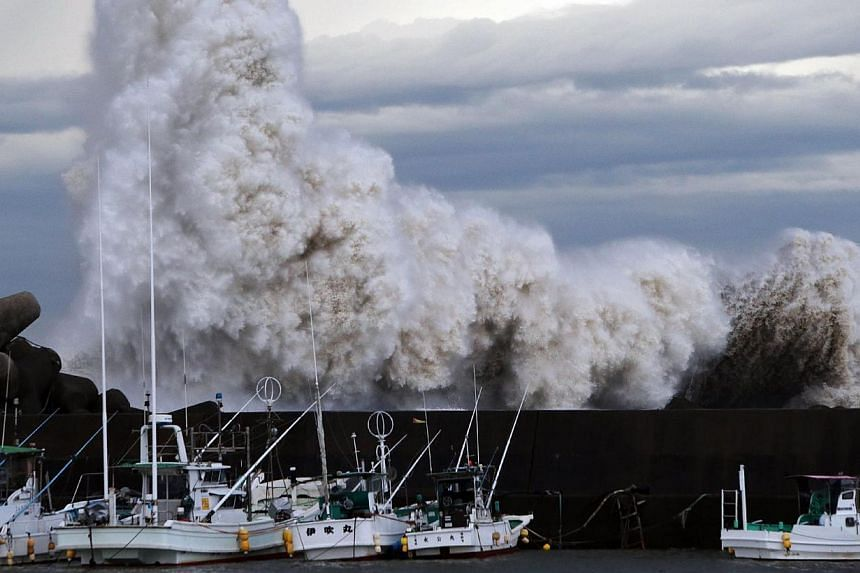 High waves batter a breakwater at a port at Kihou town in Mie prefecture, central Japan on Oct 6, 2014. -- PHOTO: AFP