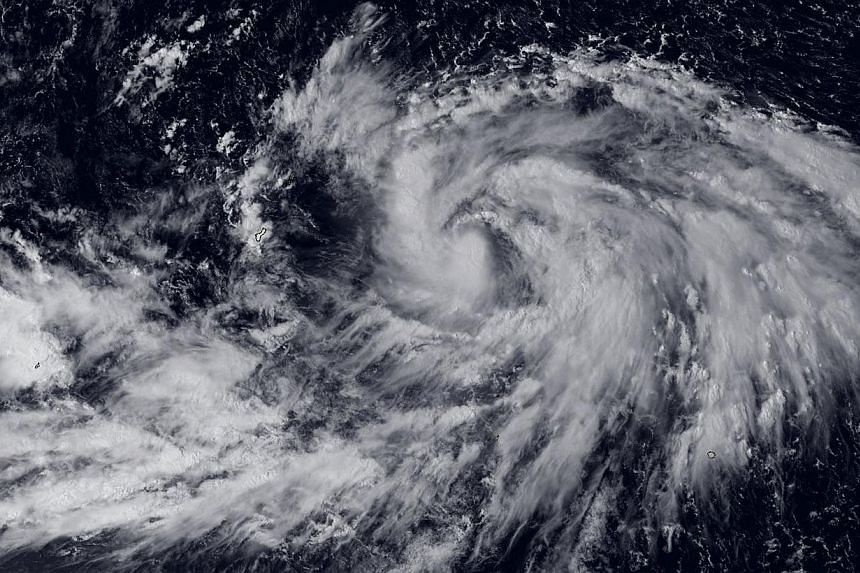 This National Oceanic and Atmospheric Administration image obtained on Sept 30, 2014 shows Tropical Storm Phanfone located east of Guam. -- PHOTO: AFP