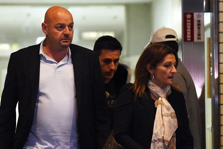 Parents of Marussia driver Jules Bianchi of France, Philippe (left) and Christine (right), leave the Mie General Medical Centre in Yokkaichi on Oct 7, 2014. -- PHOTO: AFP